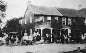 A Victorian Era Establishment with a horse drawn carridge in front